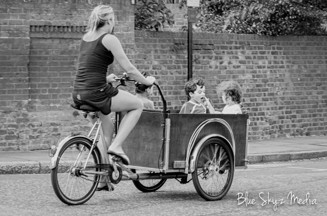 Christiania - Long, Lady in tank top and three children, b&w