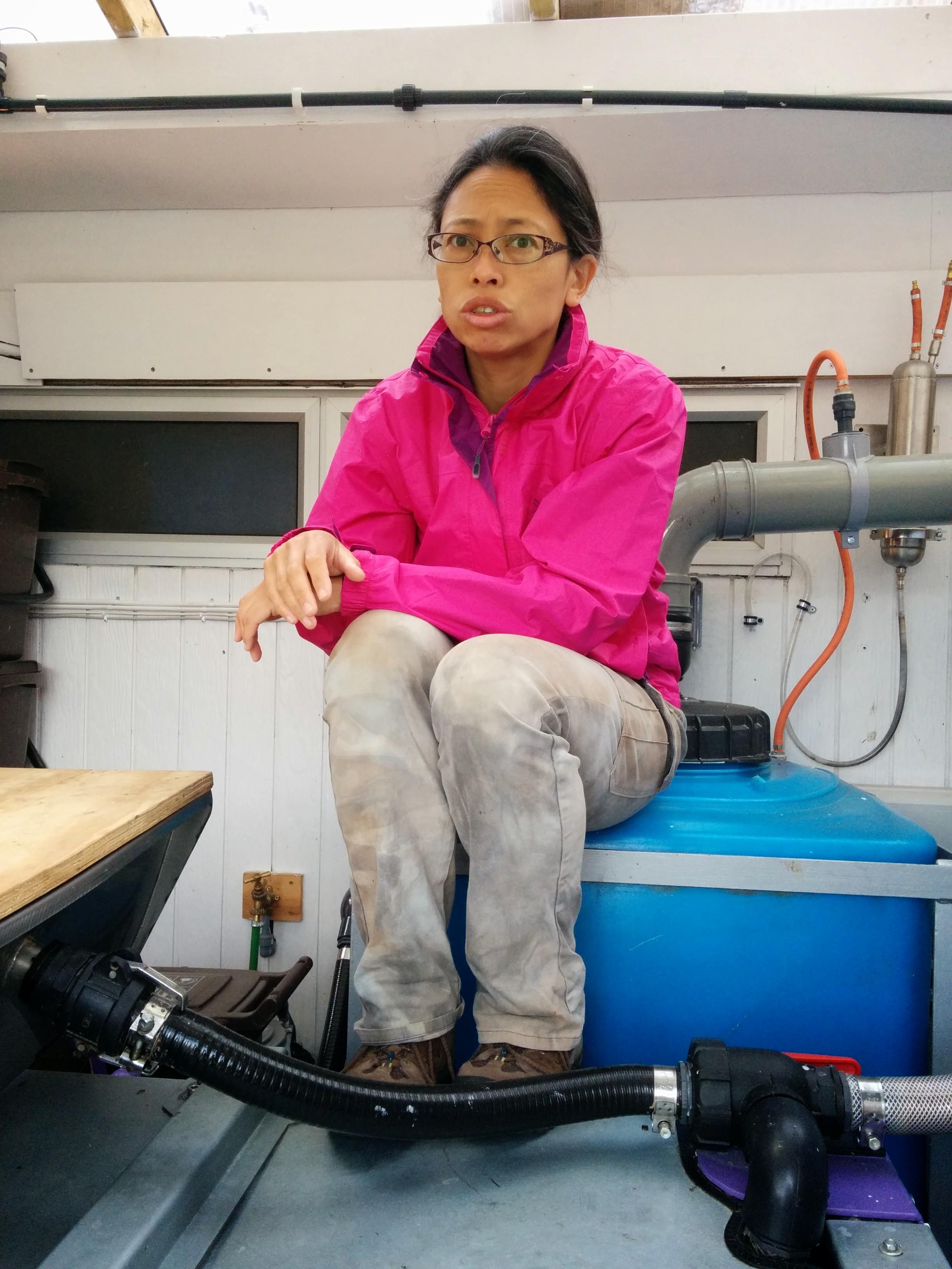 Rokiah on top of the machinery, explaining the wonders of methanogens.